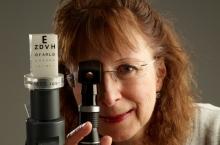 Susan Leat doing eye exam