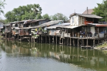 Houses on stilts in dirty water