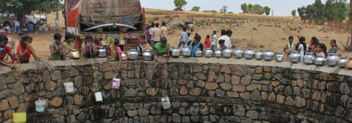 Children drawing water from well
