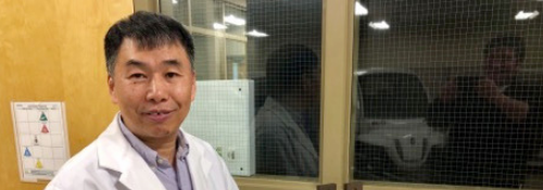 Xianguo Li with a fuel cell in his lab.