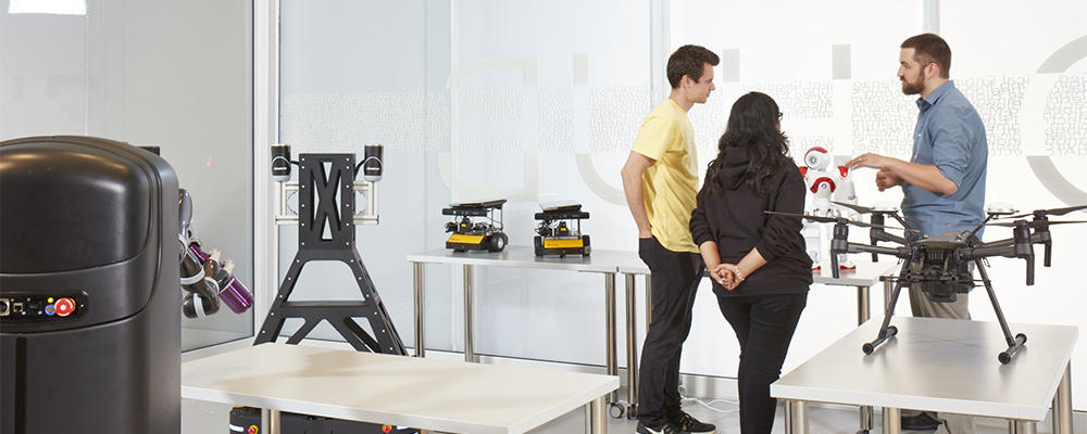 Students in the RoboHub with robots