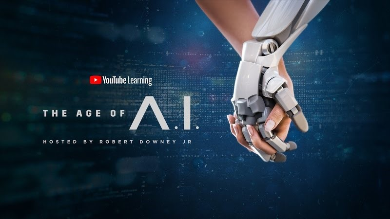 The Age of A.I. Banner with a human and robot holding hands