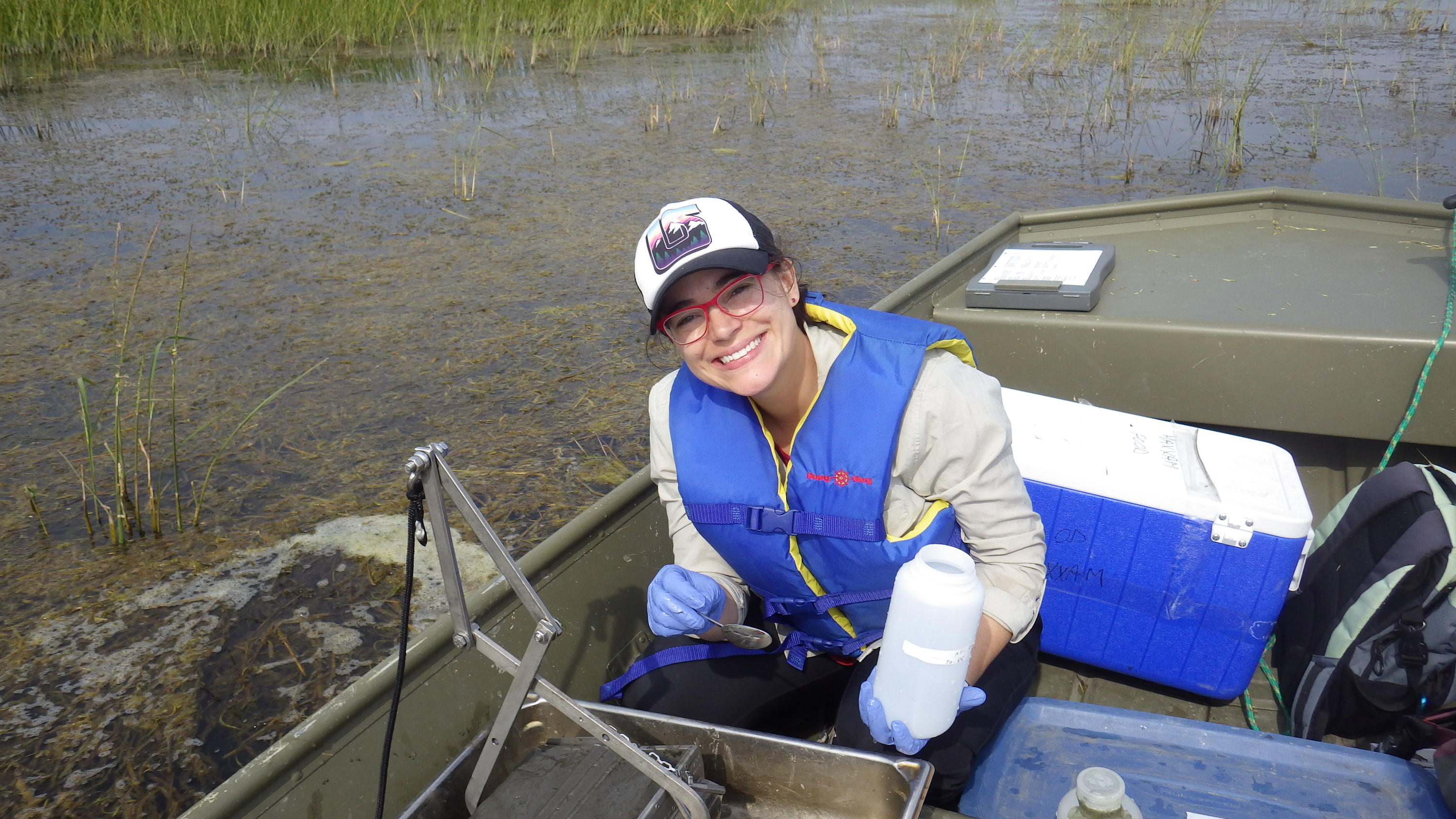 Dr. Rooney sampling sediment