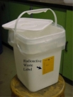 20L pail with radioactive waste label