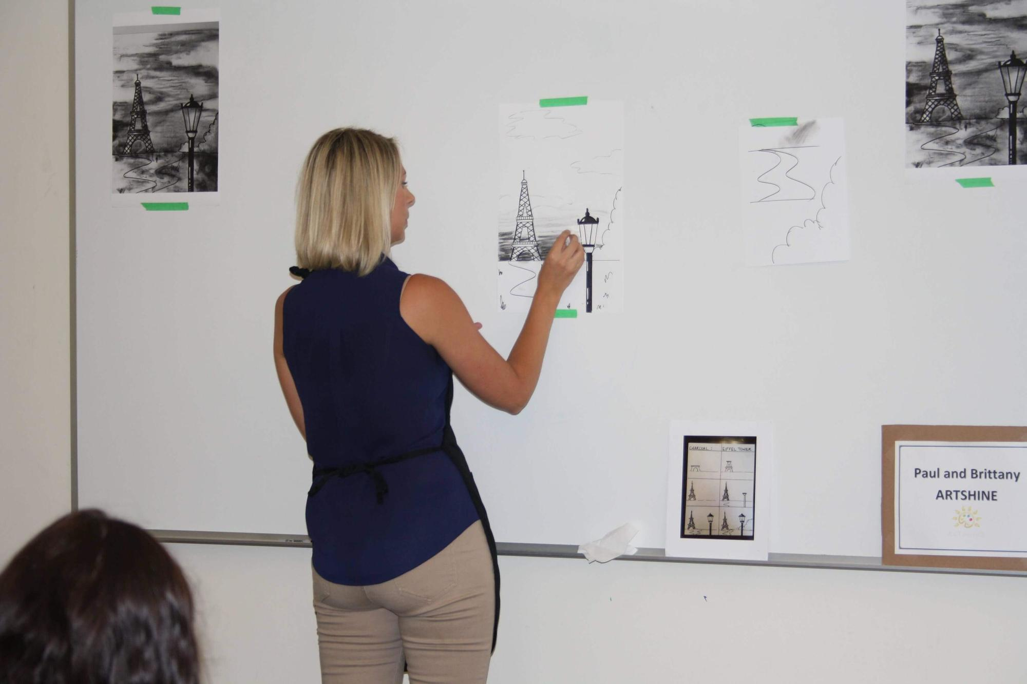 Instructor teaching how to draw
