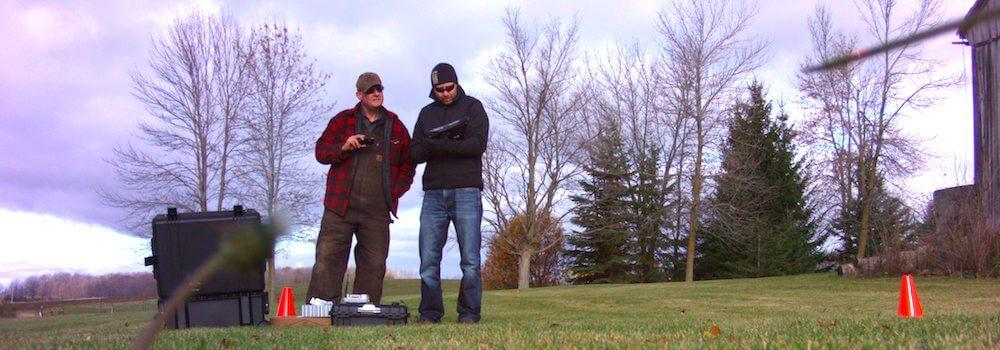 Derek and and another person setting up the controller for take-off.