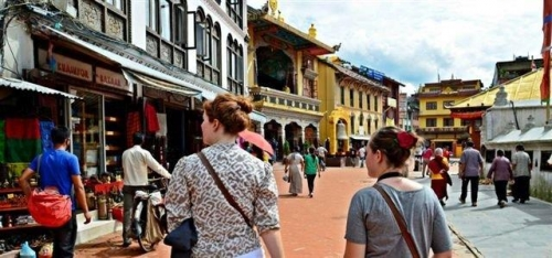 image of two female students wandering around katmandu