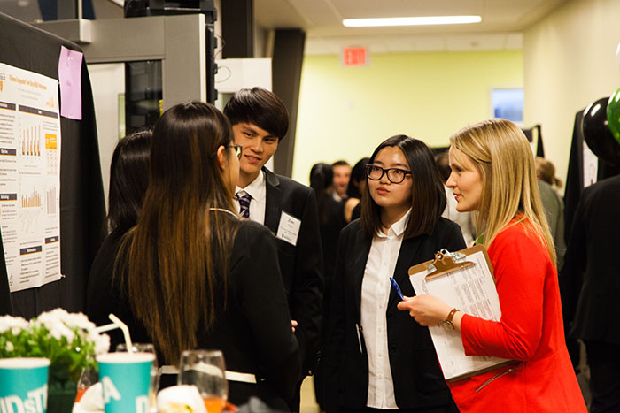 Students talking with judge at final celebration