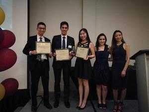 Students at Inter-Collegiate Business Competition accepting award.