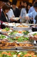 Lunch buffet table with an assortment of food platters