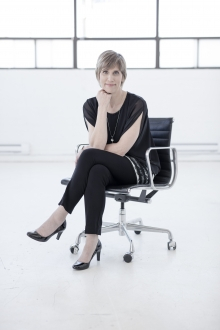 Tracy elop sitting on chair.