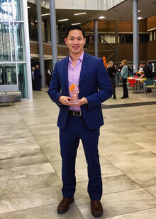 David Ha holding Faculty Excellence in Teaching award