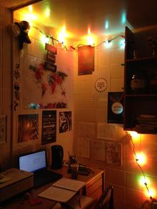 Photo of Qhalisa's dorm room decorated with posters and fairy lights