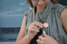 Kyrie wearing an orange beyond ideas University of Waterloo button