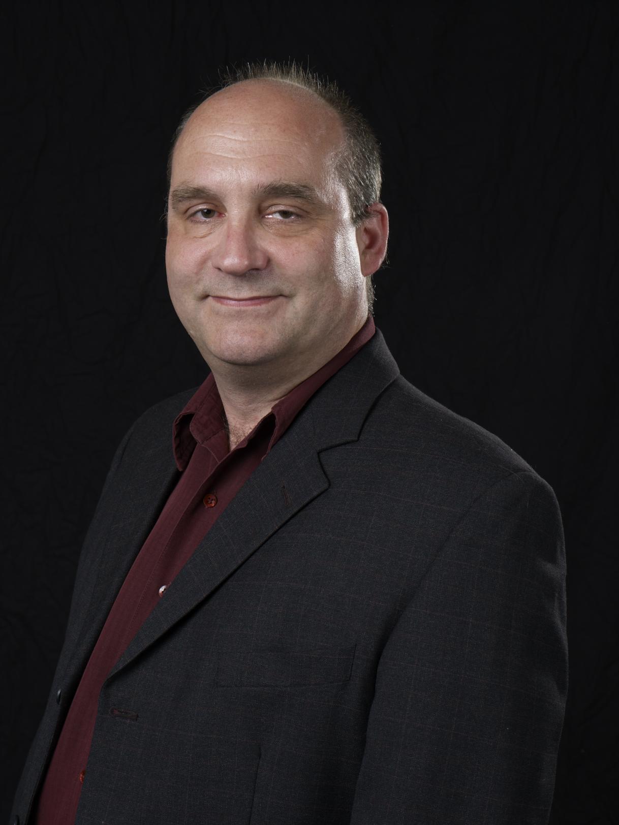 Prof. Neil Brisley