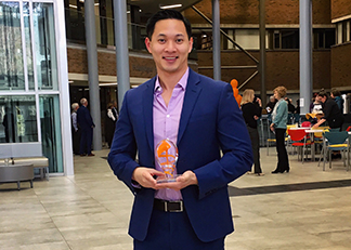 David Ha, holding Faculty Excellence in Teaching Award