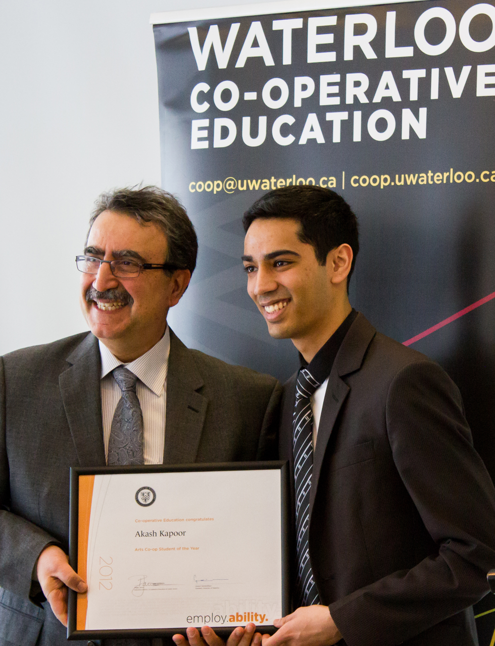 Akash Kapoor accepting the 2012 Co-op Student of the Year awarad from President Feridun Hamdullahpur