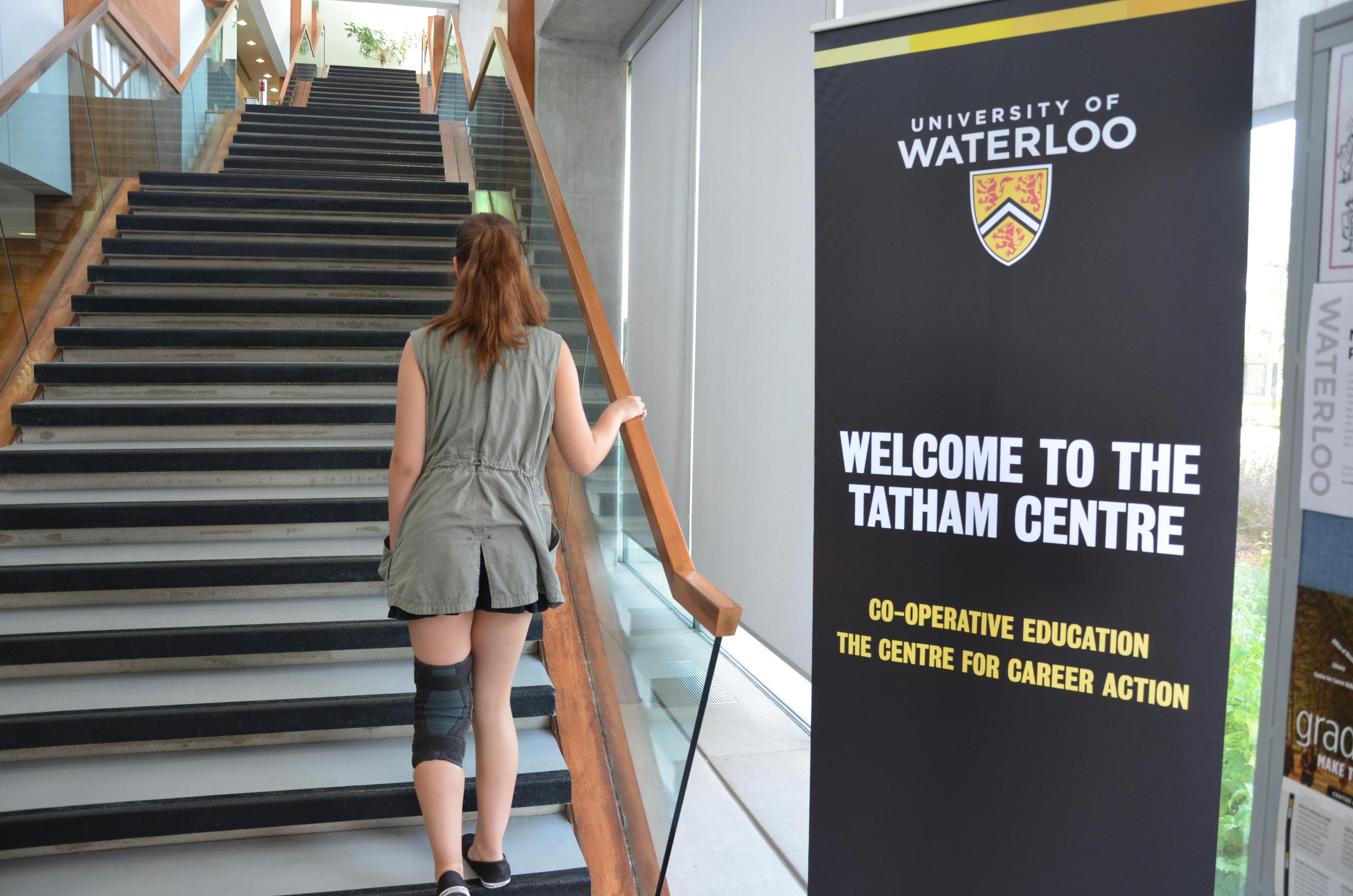 Kyrie walking up the stairs at the Tatham Centre