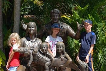 children posing on buddha