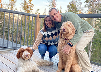 Tracy Hilpert and partner with dogs