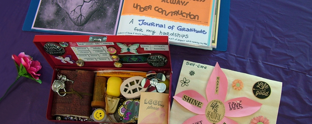 image of treasure box, flower and self-care journal