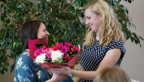 field instructor receiving flowers from a student