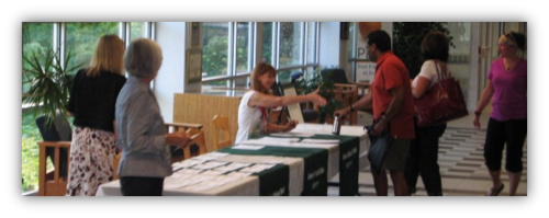 students at a registration desk