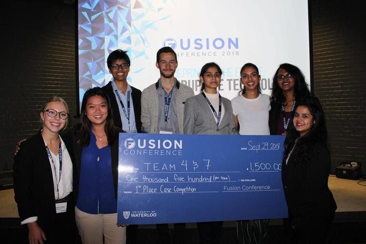 fusion conference winners with their cheque