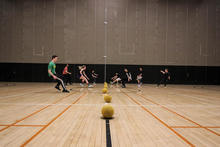 Students from all years in Science and Business and other Science programs racing to get the balls at the beginning of the game at SBSA's Dodgeball Tournament in the Winter 2018 term.