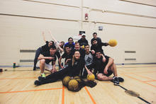 Students from all years in Science and Business and other Science programs smiling after playing an exciting game of Dodgeball at SBSA's Dodgeball Tournament in the Physical Activities Complex (PAC) on campus at the end of the Winter 2018 term.