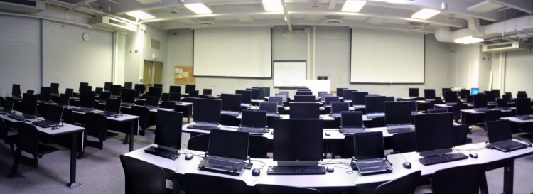 photo depicts the 120-seat B1-370 computing lab with dual projection screens and whiteboard