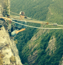 Brent Plumley securing a highline rope to a cliff
