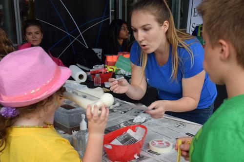 Volunter making bone models with kids