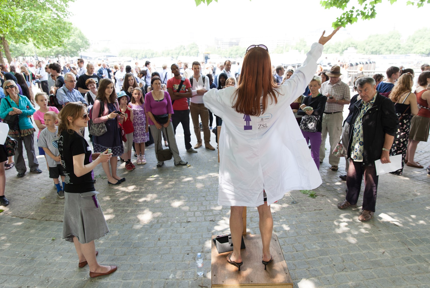 Scientist speaking to a crowd from a soapbox