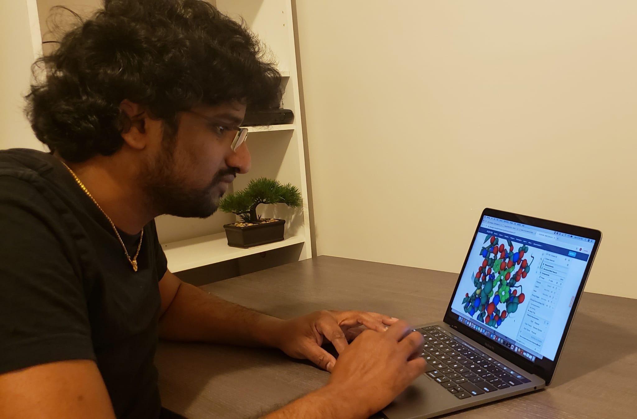 Aravindhan Ganesan working at a computer.