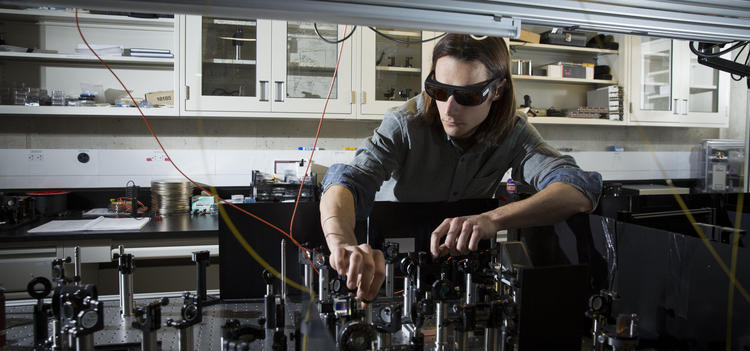 Jean-Philippe MacLean works on his quantum optics experiment designed to capture images of ultrafast energy-time entangled photo