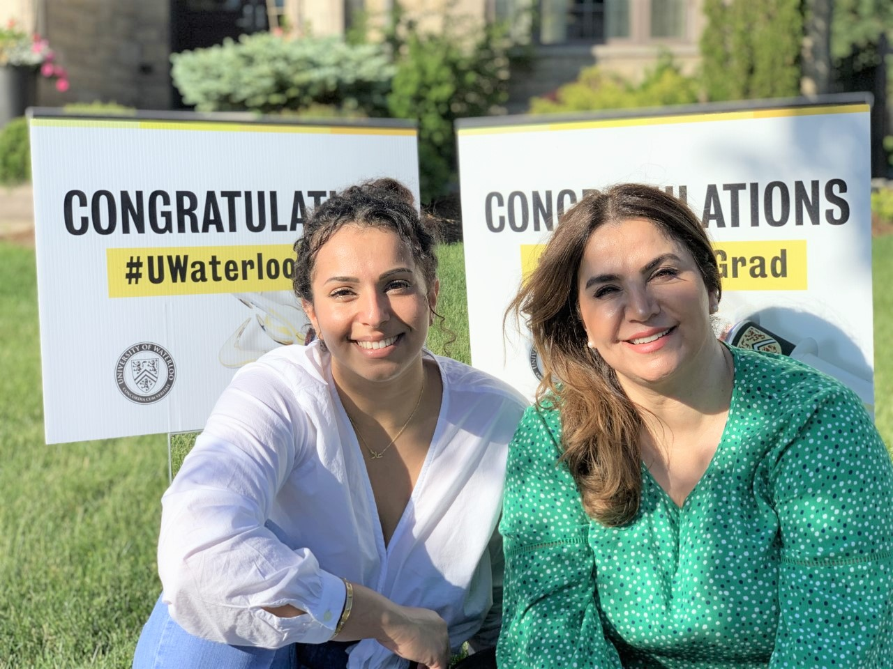 Ola Elkhatib and Abir Khaled in front of their UWaterloo convocation lawn signs