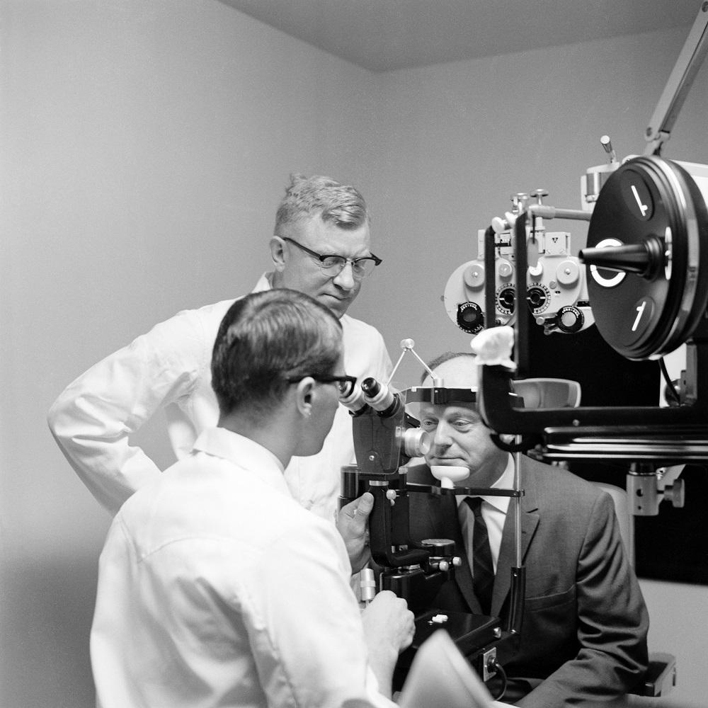 Len Koltun giving eye exam to Peter McBryde