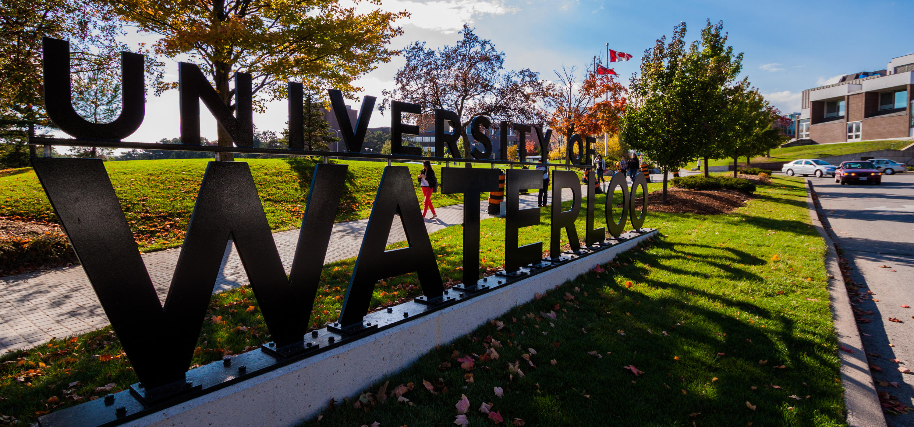 Steel University of Waterloo sign by campus entrance