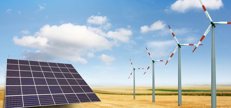 Solar panel and wind turbines in a field.