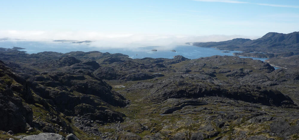 Scenic photo from Greenland showing hills surrounding a bay