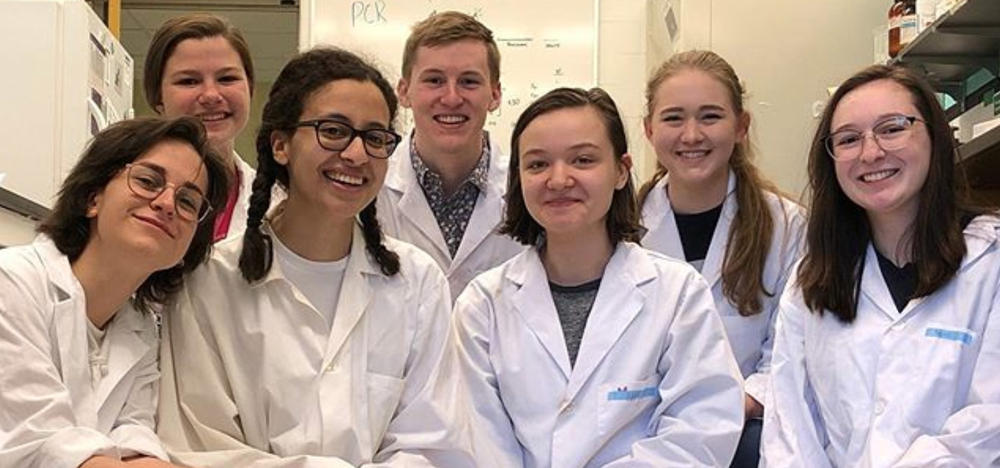 members of the iGEM team in lab coats