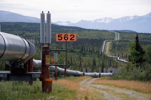 oil pipeline to distant forested hills
