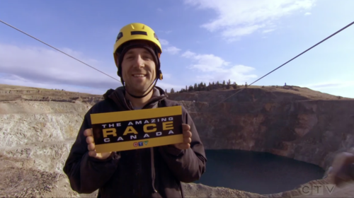 Brent Plumley handing out Amazing Race Canada clue