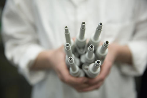 Student holding pipettes