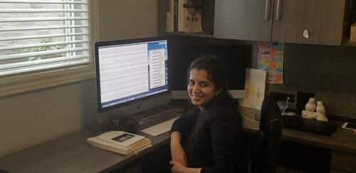 Subha Kalyaanamoorthy at her computer in her home office.