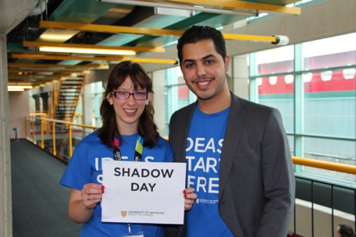 shadow day volunteers holding sign