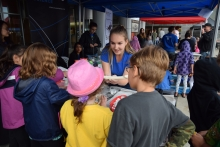 Let's Talk Science Volunteer showing children a fossil
