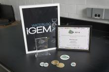 iGEM wins Gold and Best Poster awards.
