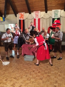 A traditional Oktoberfest keg tapping closed the conference.